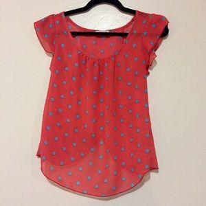 Flowy orange chiffon blouse with polka dots